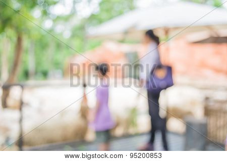 Image Of Blur People Feeding Animals  With Bokeh