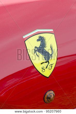 A Ferrari logo.