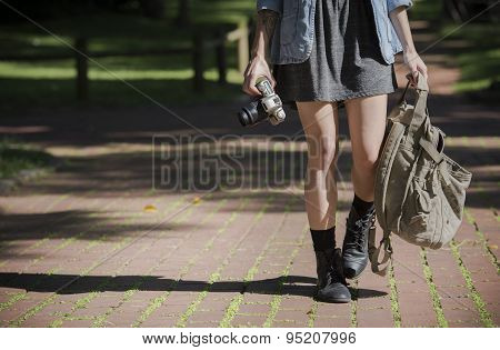 Young Happy Traveler Exploring Surrounds With Film Camera