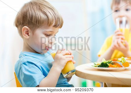 Children Drinking Juice At Nursery Or At Home