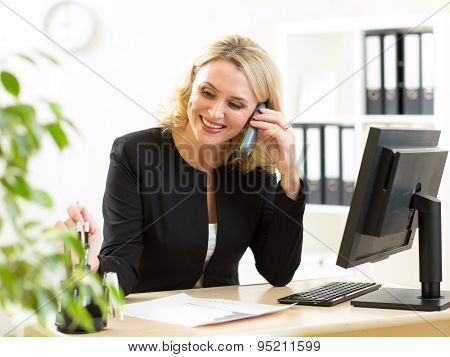 Business Concept - Business Woman Talking On The Phone In Office