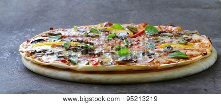 traditional Italian pizza with mushrooms, peppers and pancetta