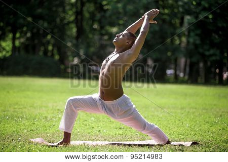 Warrior 1 Yoga Pose In Park