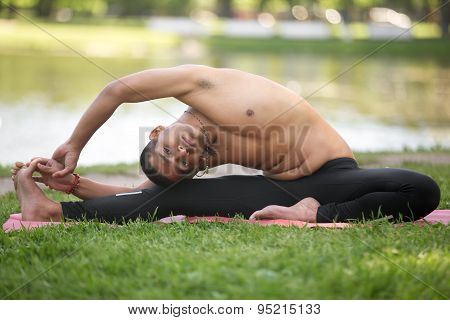 Revolved Head To Knee Yoga Pose