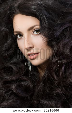 Close-up portrait of elegant woman with beautiful black hair