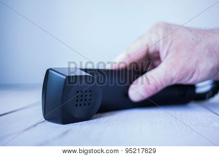Picking up phone receiver
