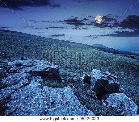White Boulders On The Hillside At Night