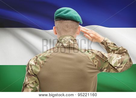 National Military Forces With Flag On Background Conceptual Series - Lesotho
