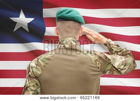 National Military Forces With Flag On Background Conceptual Series - Liberia