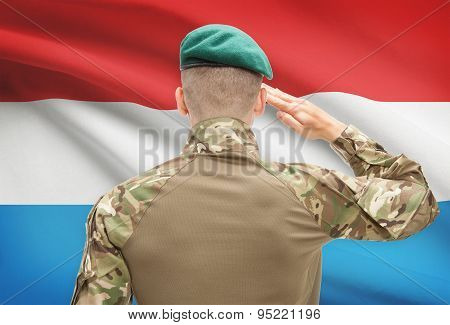 National Military Forces With Flag On Background Conceptual Series - Luxembourg