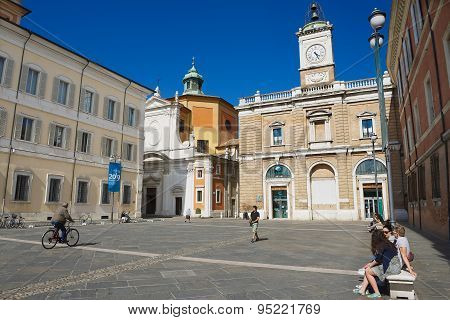 Tourists walk by the square in Ravenna, Italy.