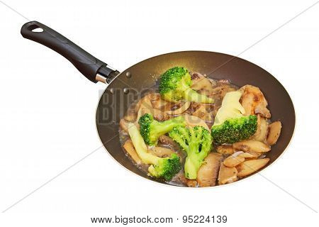Roasted Mushrooms And Broccoli In Frying Pan.isolated.