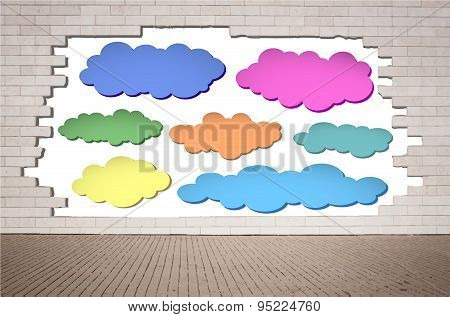 Set of colorful clouds, speech bubbles on cracked brick wall with sidewalk