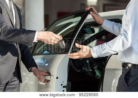 Salesman's Hands Giving Key