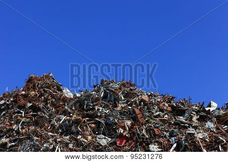Scrap metal yard with clear blue sky