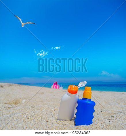 Seagull Flying Over The Suntan Lotion Bottles