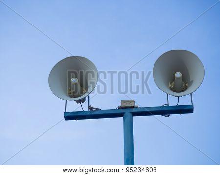 Loudspeakers Against On Blue Sky Background.