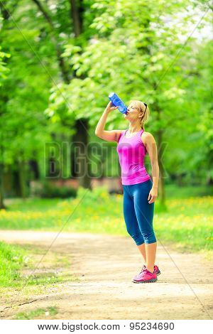 Woman Runner Drinking Water On Training