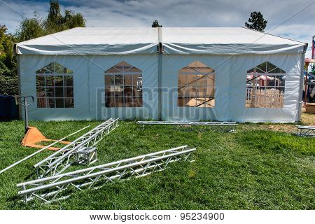 Side Of White Tent With Windows And Grass