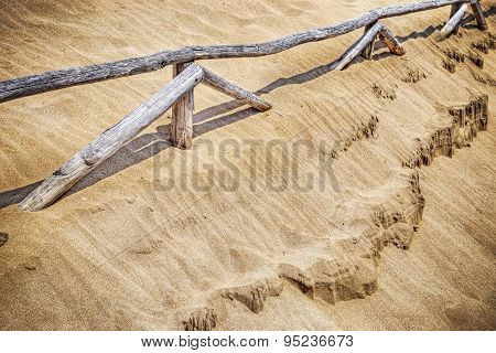 Wooden Palisades And Golden Sand