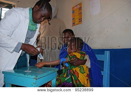 An Unidentified Child Is Subjected To Hiv Tests In The Dispensary in Pomerini-Tanzania