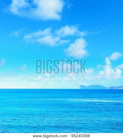Capo Caccia Under A Blue Sky With Clouds