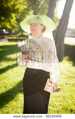 Woman With Fan In The Park