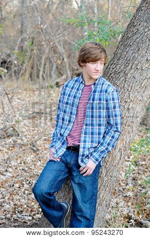 Handsome Teen Boy Leaning On Tree
