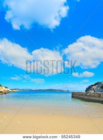 Golden Shore Under A Cloudy Sky In Sardinia