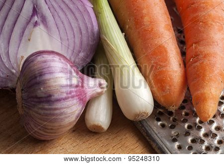 Onion, Garlic Carrots And Old Grater
