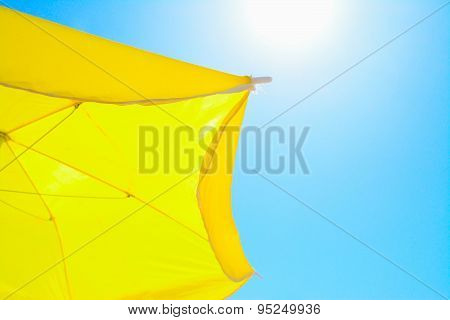 Yellow Parasol Under A Shining Sun