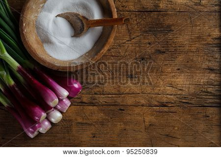 Wooden Salt Storage And Onions