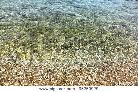 Rocks Under The Water On The Ocean
