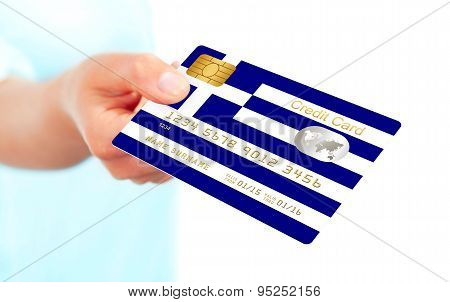 Greek Credit Card Holded By Hand Isolated Over White