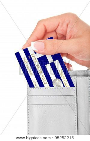 Hand Holding Greek Credit Card In Wallet Isolated Over White