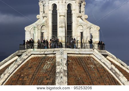 Tourists On The Top Of Brunelleschi's Dome In Florence, Italy