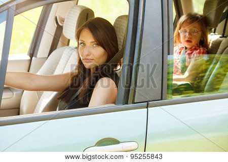 Mother Driver And Little Girl In Car Safety Seat.