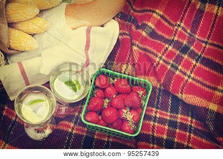Picnic Basket With Berries, Lemonade, Corn And Bread.