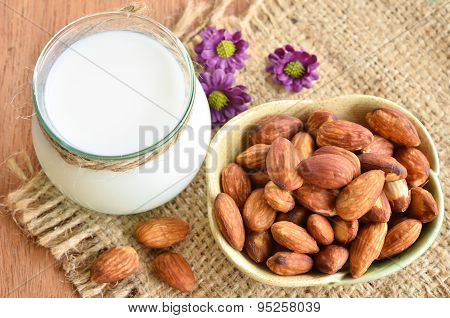 Glass Of Almond Milk With Almonds.