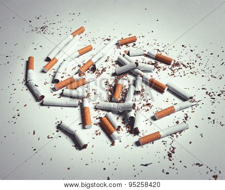 closeup of many dirty cigarettes