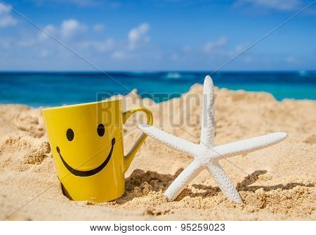 Starfish With Mug On The Sandy Beach