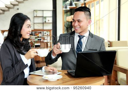 Two Business People Look Happy While Having A Coffee Break