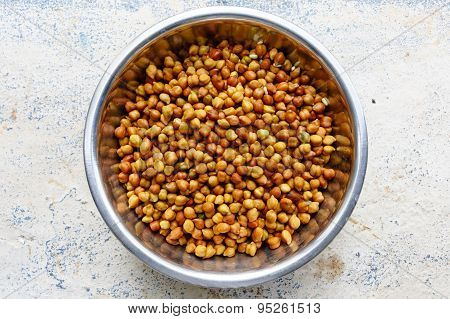 KALA CHANA ~ Water soaked black gram kept in a bowl on a plain background
