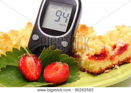 Glucose Meter And Pieces Of Yeast Cake With Strawberries