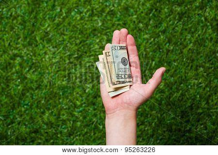 Human hand holding money