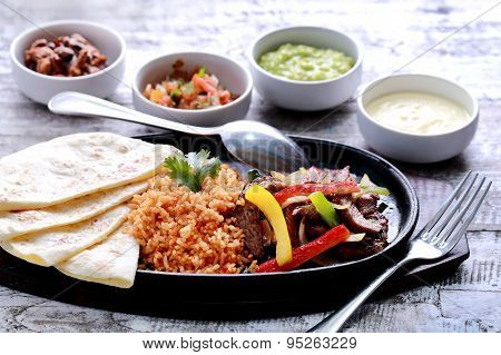 Mexican Beef Fajitas With Four Different Sauces