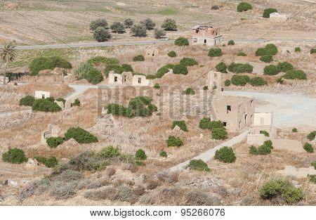 Abandoned Village With Deserted And Collapsed Houses