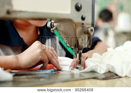 Worker Using Industrial Sewing Machine