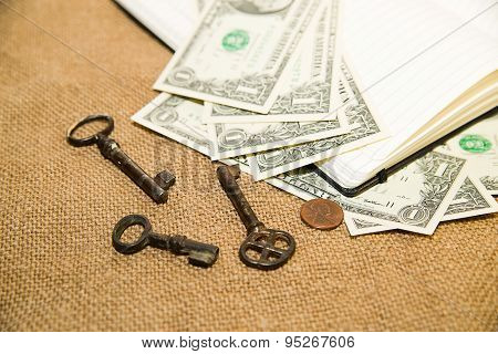 Opened Notebook, Keys And Money On The Old Tissue