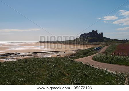 Bamburgh Castle and beech with tide out